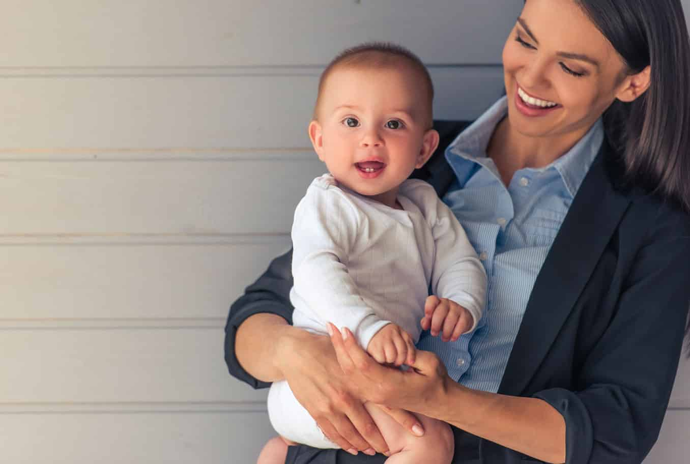 Family lawyer holding a baby during a divorce proceeding